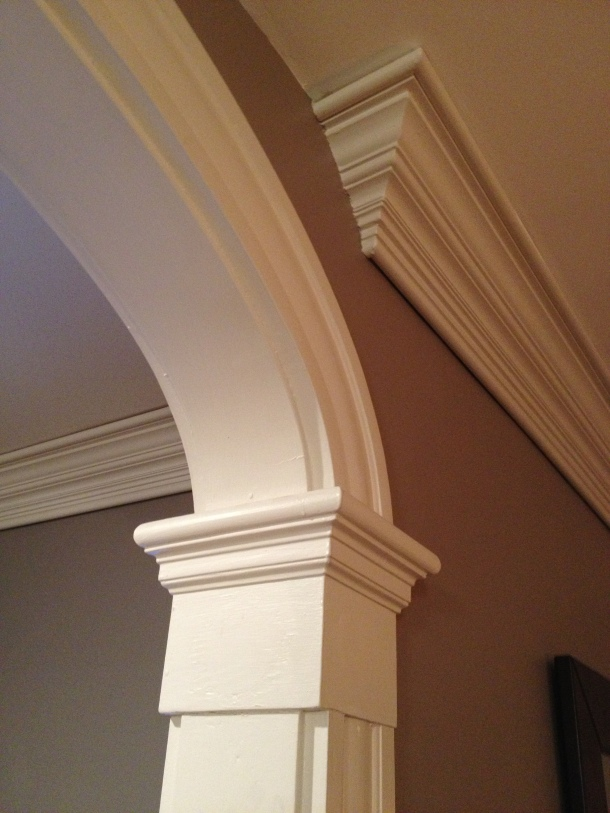This custom three piece crown molding, designed by Ben Becker, features a main custom profiled molding. Pencil bead molding with a shadow cut was added to the top and bottom to create depth and character to the space to the dining space.