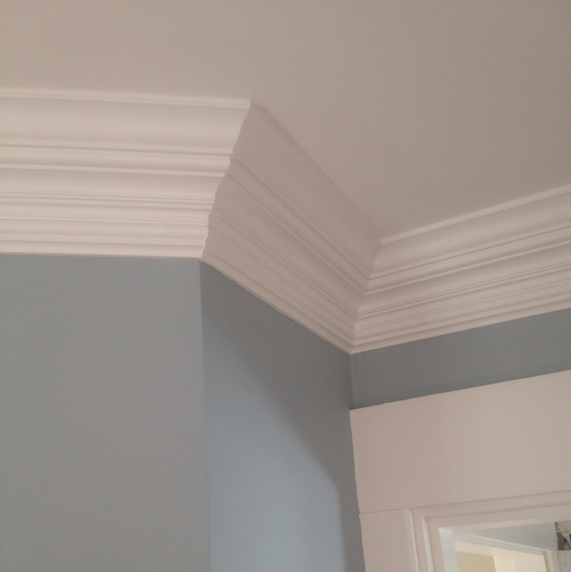 Custom two piece crown molding, designed by Ben Becker, features an added bottom layer underneath the main custom profiled molding to create a more elaborate design element to this guest bedroom.